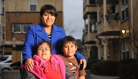 photo of Mom and two kids from Mercy Housing Seattle
